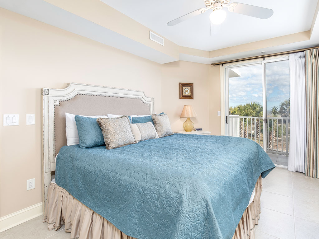 Bedroom with sunrise ocean views and access to a private balcony.