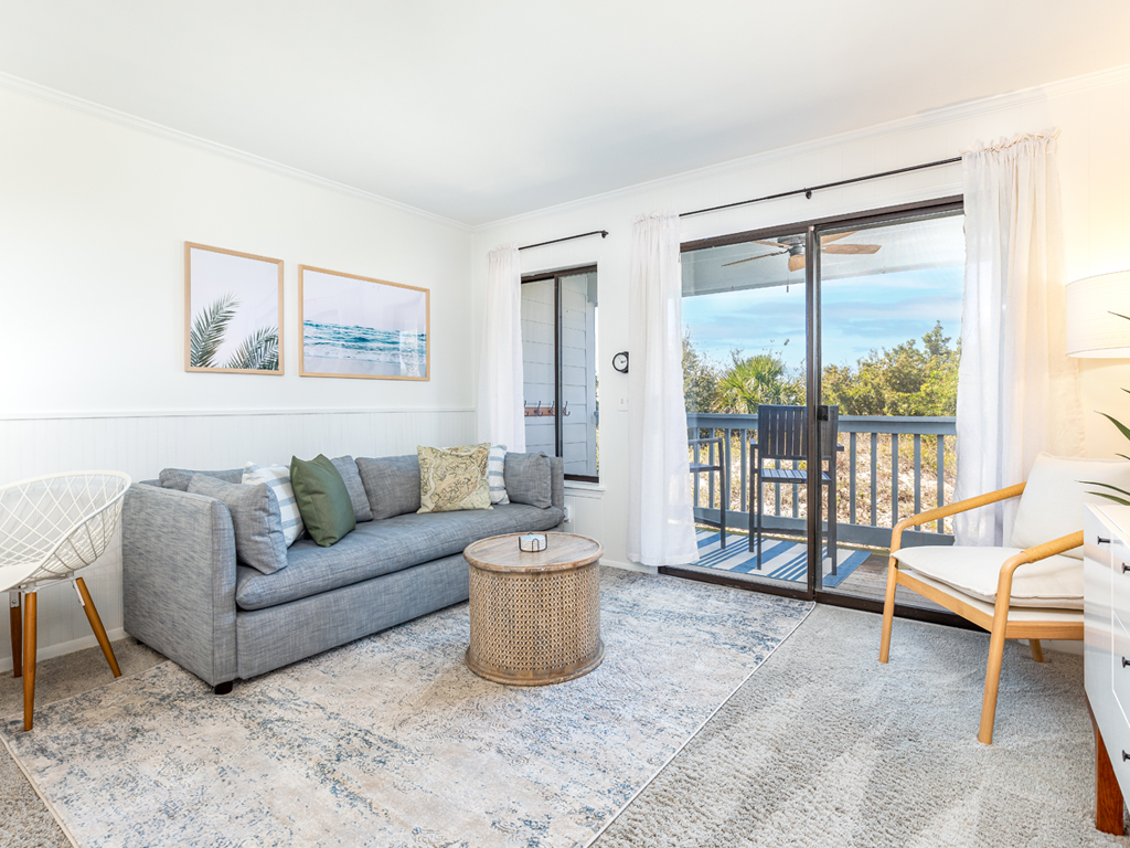 Living of a condo with access to balcony