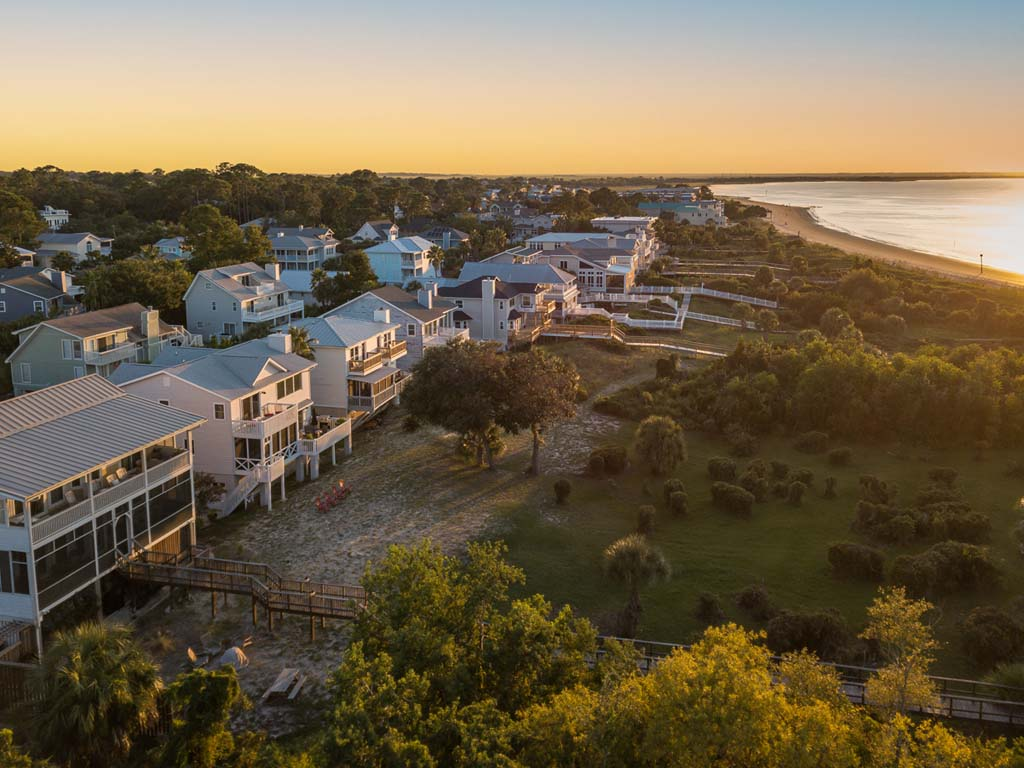 Drone photo of homes along North Beach at sunset